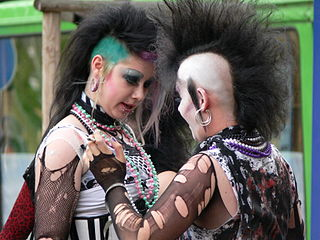 Two goth girls with deathhawk style hair