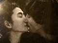 Yoko Ono and John Lennon kissing