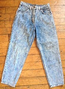 An original pair of Levi's 501 acid-washed high waisted jeans from the 80s