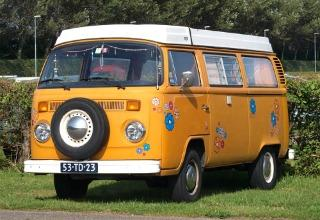Orange VW Type 2 (T2) flower power camper