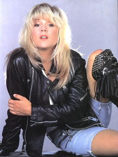 Samantha Fox in the 80s wearing leather jacket and denim shorts