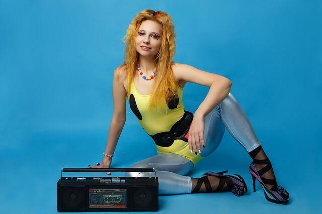 80s Workout - girl sat by boombox wearing leotard and leggings