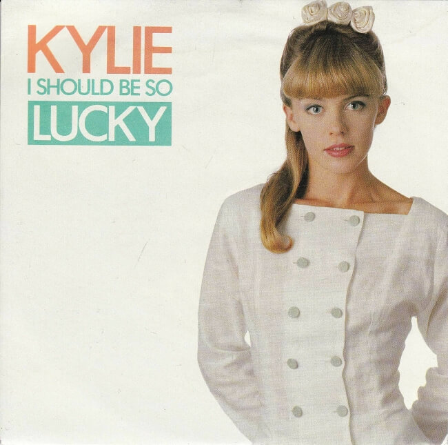 MAR 25 - I SHOULD BE SO LUCKY by Kylie Minogue. Video and song review with sleeve photos.