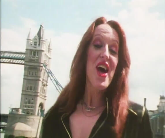 Kelly Marie near Tower Bridge in the video for Feels Like I'm in Love