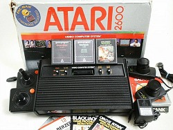Atari 2600 games console with box, controllers and games
