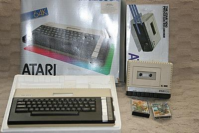 Atari 800XL home computer with Atari 1010 cassette recorder and boxes