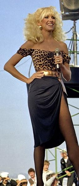 Actress Suzanne Somers wearing and off shoulder leopard print top with big belt in 1981