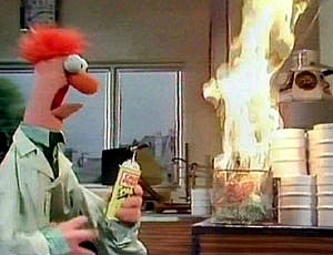 Beaker muppet character setting fire to kitchen