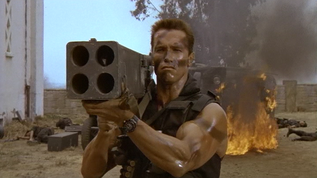 Arnie as John Matrix carrying a rocket launcher