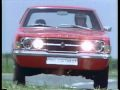Red Ford Cortina with lights on