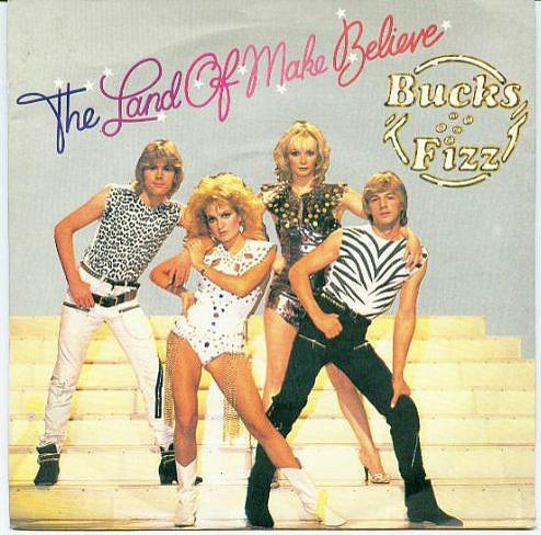 JAN 5 - BUCKS FIZZ - THE LAND OF MAKE BELIEVE. A review of the group's second No.1 single, with video and vinyl sleeve photo.