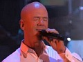 Jimmy SOmerville sings with a street musician while walking his dog!