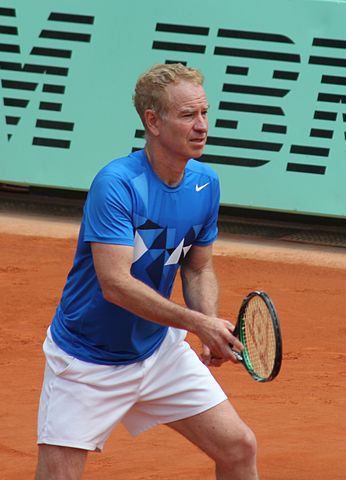 John McEnroe playing tennis in 2012