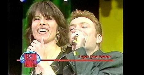 Ali Campbell and Chrissie Hynde singing
