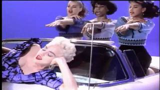 Video still from True Blue ft. Madonna and open top car with three dancing girls