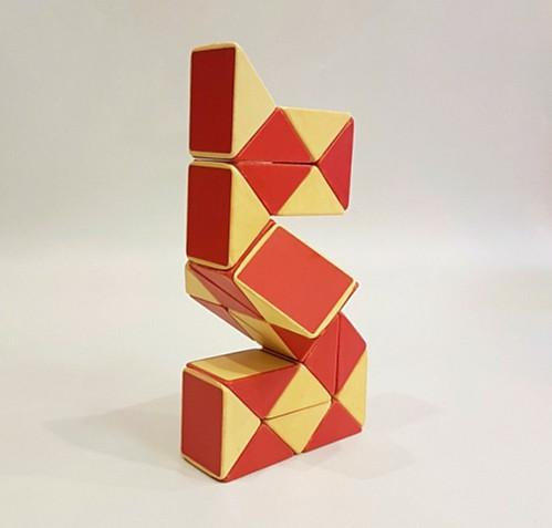 An original 1980s Rubik's Snake - red and cream