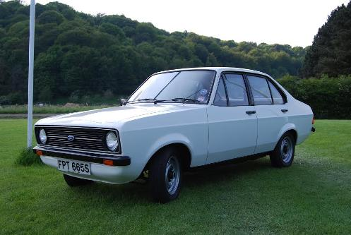 Angled front view of a White Ford Escort Popular Plus Mk2 - take by John Lonergan (c)