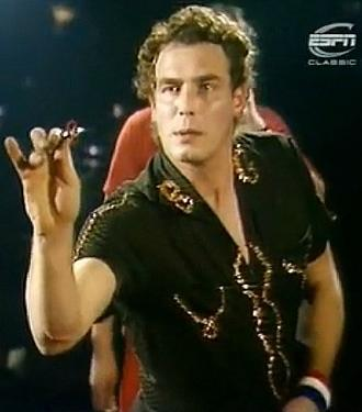 Bobby George playing darts in the 1980s