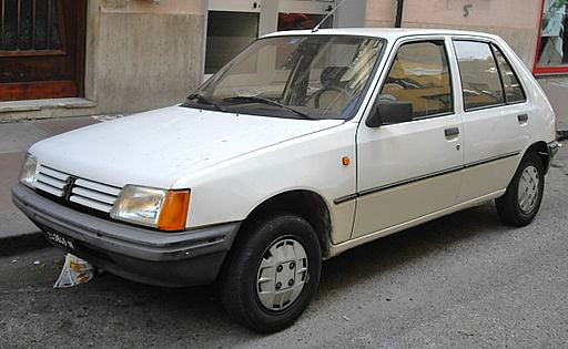 white Peugeot 205 with french plate