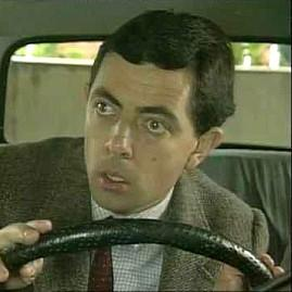 Mr Bean driving his mini