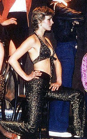 Swedish model Ulla Jones dressed in a lurex halter top and matching flared trousers (1976)